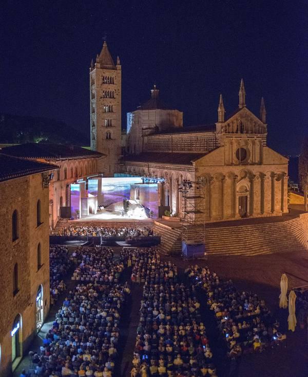 """Photo of Massa Marittima: pronto il programma di """"Lirica in Piazza"""" con La Bohème, Aida e il Flauto Magico"""